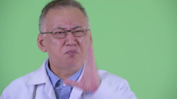 Thumbnail for Face of Stressed Mature Japanese Man Doctor Getting Bad News