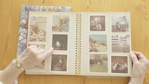 Senior Woman Looking at An Old Photo Album