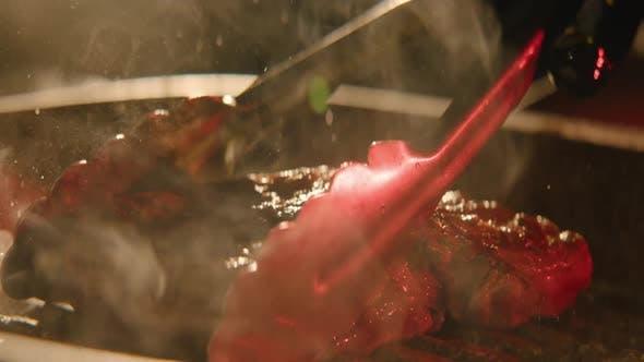Thumbnail for a Chef Preparing Steak Close-up