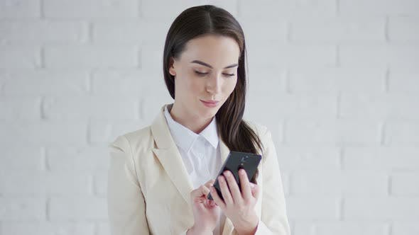 Thumbnail for Beautiful Elegant Business Woman Browsing Her Smartphone