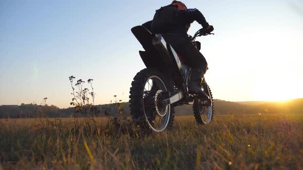 Thumbnail for Wheel of Motocross Bike Starting To Spin and Kicking Up Ground or Dirt. Motorcycle Beginning the