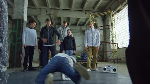 Teenage Boy Spinning in Handstand