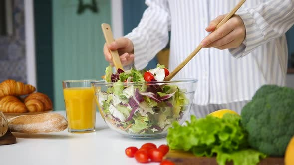 Thumbnail for Close-Up Of Female Hands Mixing Healthy Salad On The Kitchen. Slow Motion.