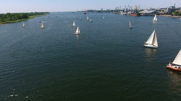 Cover Image for Aerial Shot of Numerous Yachts Sailing in the Dnipro River on a Sunny Day
