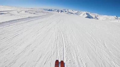 First Person View of Skiers Riding Downhill