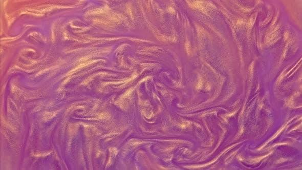 Gold purple glitter fluid liquid motion background. Shine pink color metallic paint.