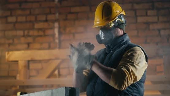 Male Builder Cleaning Nose During Work