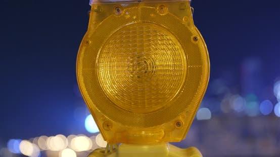 Thumbnail for Yellow road construction warning light at night