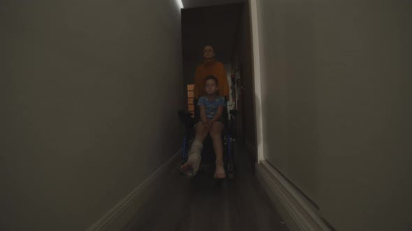 Thumbnail for Mom with Injured Son in Wheelchair