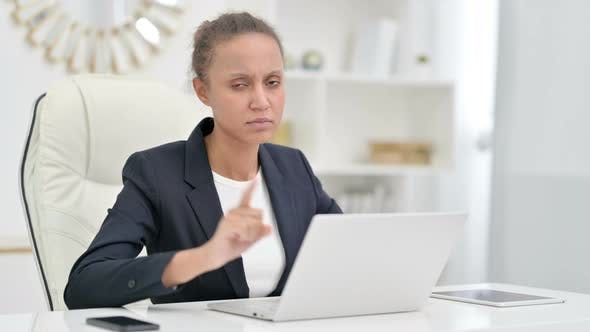 Thumbnail for Serious African Businesswoman with Laptop Saying No with Finger