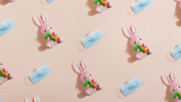 Pink Plush Little Easter Bunny with a Ginger Carrot with Blue Medical Mask