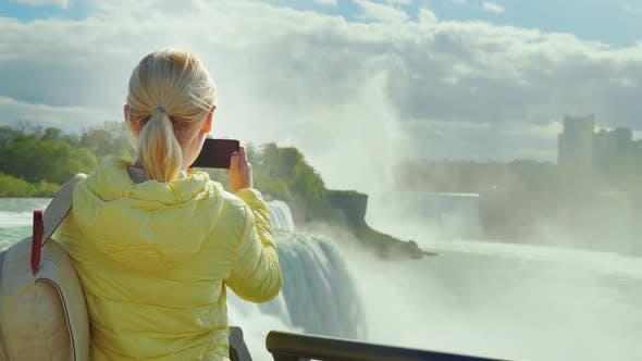 Thumbnail for A Woman Tourist Takes Pictures of Niagara Falls in the USA