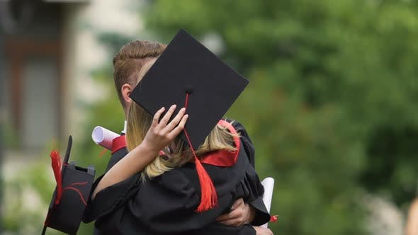 Thumbnail for Slow Motion of Successful University Graduates Hugging and Laughing Sincerely