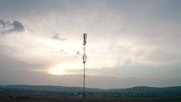 Aerial Drone View. Communication Transmitter Tower in the Countryside