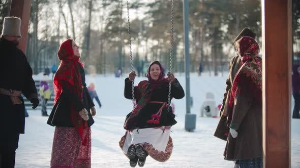 Thumbnail for Russian Folklore - Russian Girl Swinging and Everyone Is Laughing