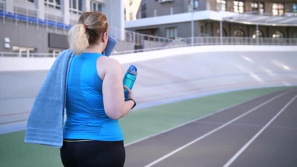 Thumbnail for Plus Size Female Walking Along Track After Running