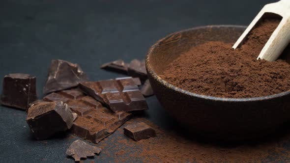 Thumbnail for Dark Chocolate Chunks and Cocoa Powder in Wooden Bowl on Dark Concrete Background