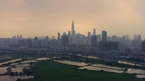Skyline of Shenzhen City, China at twilight. Viewed from Hong Kong border.