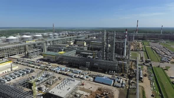 Thumbnail for An Aerial View of a Large Oil Refining Station Against Green Landscape