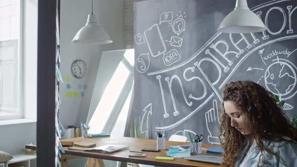 Cover Image for Young Woman Using Laptop on Lap while Working in Office