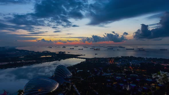 Thumbnail for Time Lapse shot a beautiful sunrise and cargo ships off the coast of Singapore