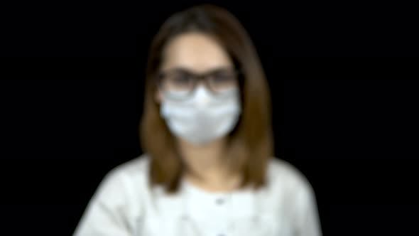 Thumbnail for Sperm in a Test Bank Close-up. Woman Doctor Holds Out a Jar of Sperm To the Camera on a Black