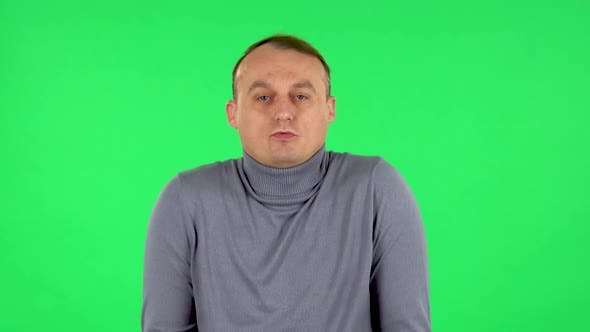 Thumbnail for Portrait of Displeased Man Indignantly Talking To Someone, Looking at the Camera. Green Screen