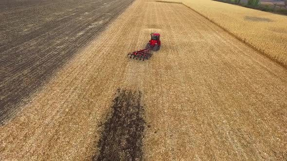 Thumbnail for Red Tractor Preparing Land for Sowing, Aerial Shot, Field Corn