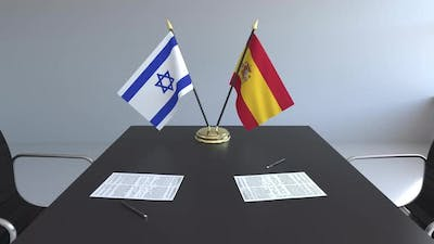 Flags of Israel and Spain on the Table