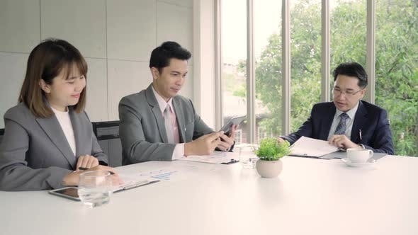 Businessman meeting in workplace with his colleague and signing a contract