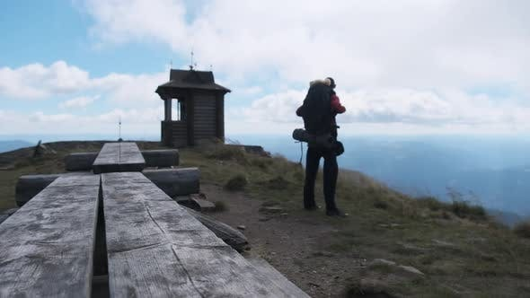 Thumbnail for Tourist with Backpack on the Top of Mountain. Achievement of Goal