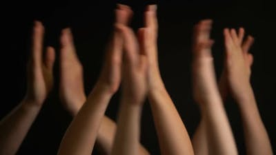 Raising Hands with Applause or Clap on Black Background