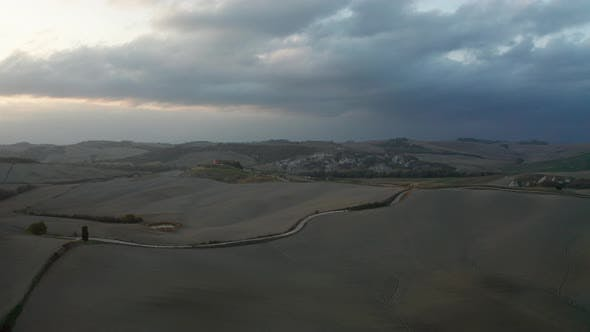Thumbnail for Aerial View of a Rural Landscape During Sunset in Tuscany. Rural Farm, Cypress Trees, Green Fields
