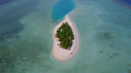 Beautiful overhead tourism shot of a sunshine white sandy paradise beach and blue water background i