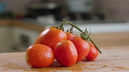 Tomato On the Table In Kitchen In House