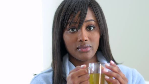 Thumbnail for Black woman drinking tea in robe