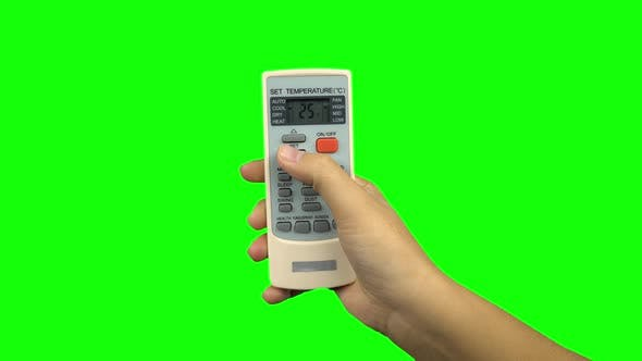Thumbnail for Hand Using a Remote Control To Change the Temperature of Air Conditioner. Green Screen