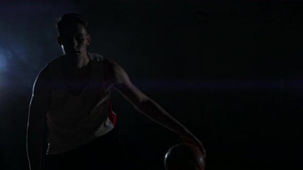 Thumbnail for Male Urban Basketball Player Dribbles Ball in Crouched Position in an Inner-city Basketball Court