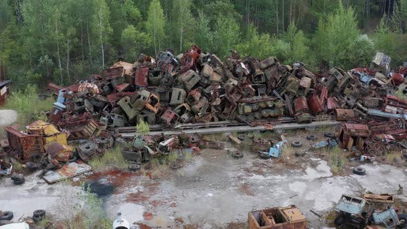 Drone Flight Over Pile of Rusty Scrap in Chernobyl