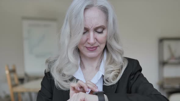 Thumbnail for Senior Businesswoman Using Smartwatch