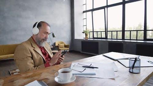 Man Relaxing and Enjoying Audio Book