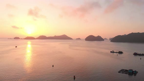 Cover Image for Aerial: sunset clear sky at Cat Ba island and beach with new tourist resort, Vietnam