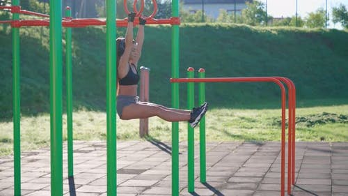 Sportswoman Hanging Off Raising Straight Legs Up