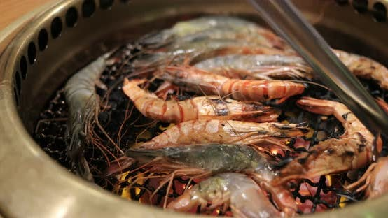 Thumbnail for Japanese style barbecue with shrimp on metal net in restaurant