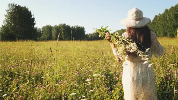 Thumbnail for Woman with Flowers Walks in The Meadow