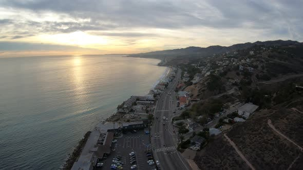 Thumbnail for Malibu California Coastline Las Flores Canyon Aerial View At Sunset Traffic On Pacific Coast Highway