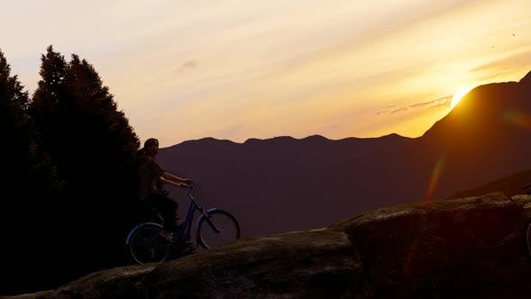 Thumbnail for Young Woman Doing Mountain Tour by Bicycle at Sunset