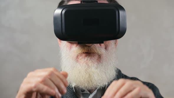 Thumbnail for Elderly Man Puts on Virtual Headset