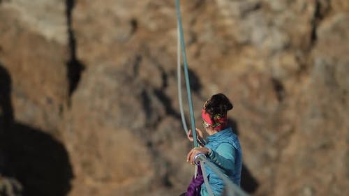 The Woman Climber Is Sent Up the Rope Across the Chasm