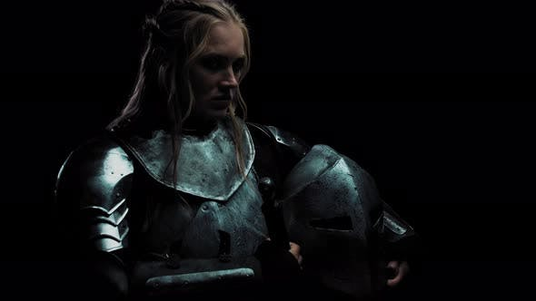 Angry Female Warrior in Medieval Metal Armor, Tough Women,